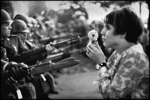 USA. Washington DC. 1967. Jan Rose KASMIR, confronts the American National Guard outside the Pentagon during the 1967 anti-Vietnam march. **RESTRICTIONS APPLY** This photograph is available for UK inside press use in relation to the The Incite Project exhibition at the Victoria Art Gallery only. Any additional usage needs to be licensed through Magnum Photos  No cropping or text overlay can occur. Marc Riboud/Magnum Photos